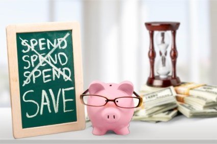 picture of piggy bank with sign which says save