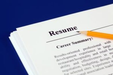 Picture of a resume with a pencil laying on top of it