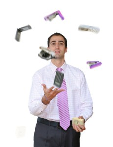 Businessman juggling his office tools