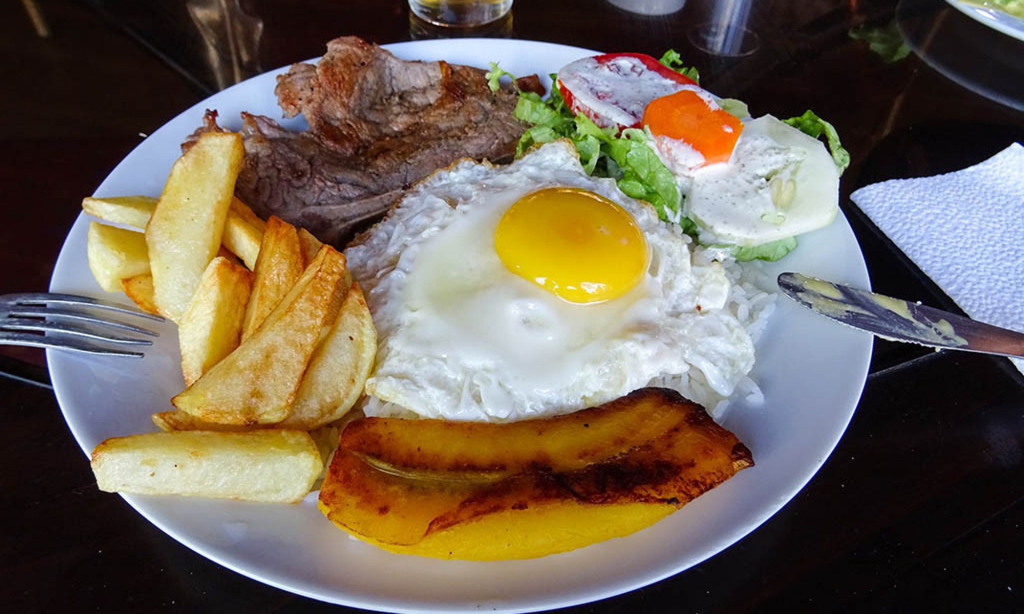 At amenú restaurant in Nazca I had a main course of steak, plantain, egg, chips and salad