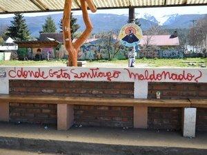 SM graffiti on bench