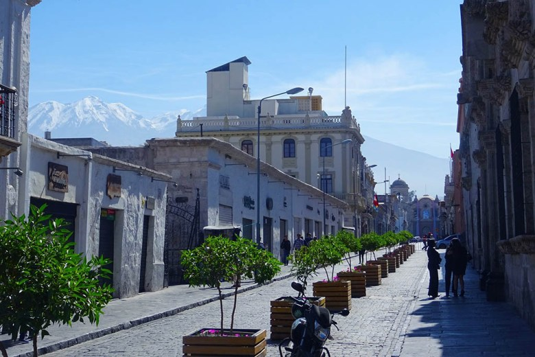 Spanish colonial architecture against a mountainous backdrop in Arequipa