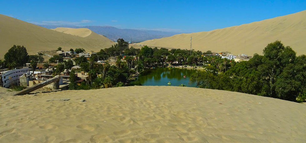 The blue lagoon is the main focal point of Huacachina, the desert oasis village of Peru