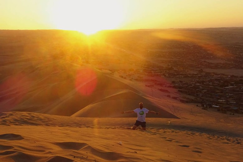 The oasis village of Huacachina is a great place to catch a stunning desert sunset