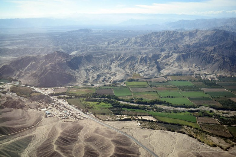 Mountains, fields and the Nazca Desert from above
