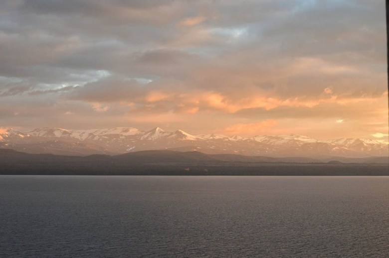 A sunrise view from Hospedaje Penthouse 1004, a 10th-floor hostel in Bariloche