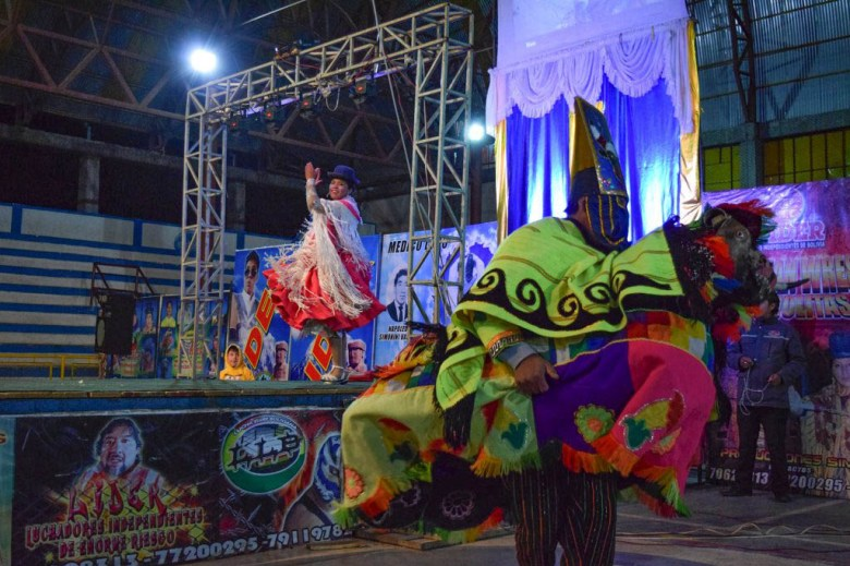 Costumed entertainers paraded around the ring in the build-up to each wrestling match