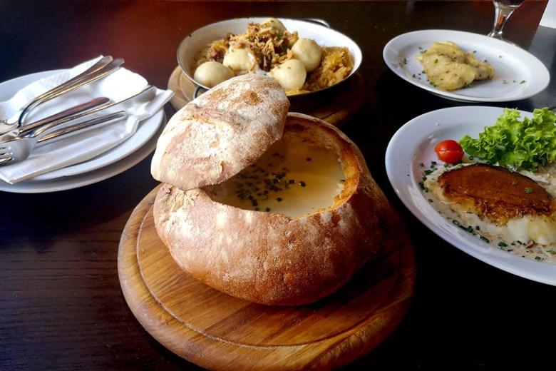 Creamy garlic soup served in a giant bread roll in Meštiansky Pivovar, Bratislava's oldest brewery