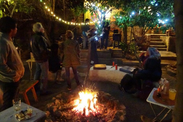 The ambiance at Rustika Restobar, with firepits and live music. is warm and welcoming