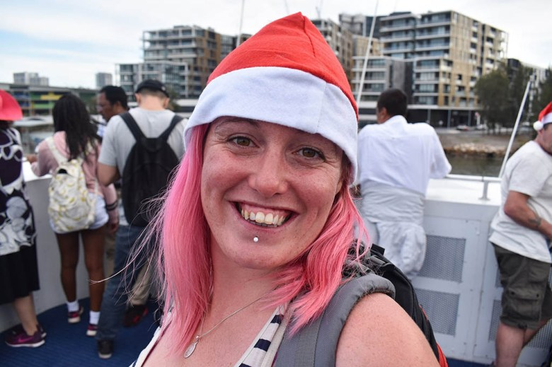 Lisa wearing a Santa hat in Sydney, Australia