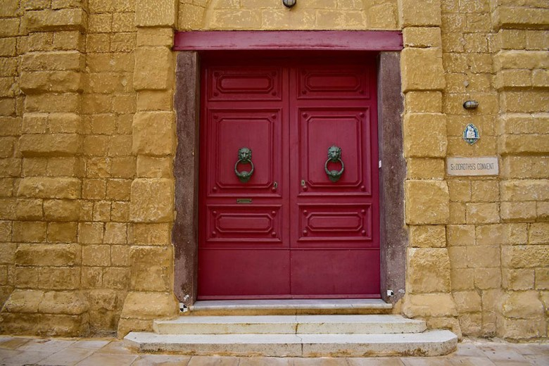 Red doorway inside the walled city of Mdina, Malta