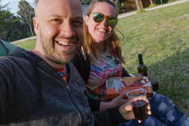 Enjoying some local wine on a campsite during our Italy trip