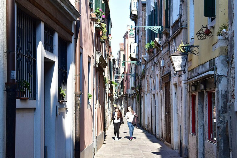 Venice is riddled with endless colourful narrow backstreets interlinking its canals and bridges