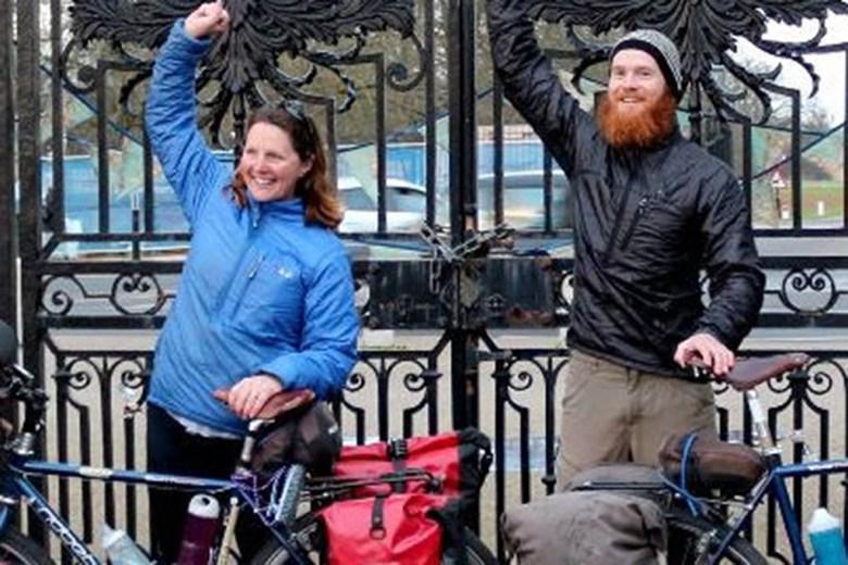 Laura and Tim after completing the 13,000-mile round-the-world cycling trip