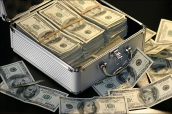 Small metal suitcase-like box full of $100 bills.