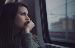 Woman riding public transportation looking out window