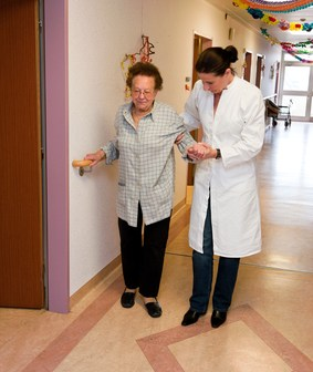 Nurses supervised old woman in a nursing home