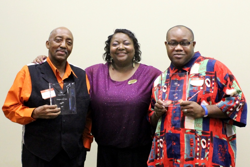 Reed Hayslett and Bryan Morton, selected to receive the Caregivers Respite Caregiver of the Year Award, with Janice Williams, who founded Caregivers Respite in 2010.