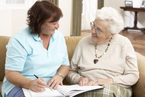 Older woman working with her advocate