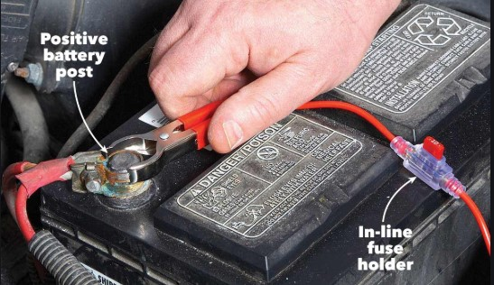 How to Install Fog Lights Connect the red wiring to the positive side of the car battery