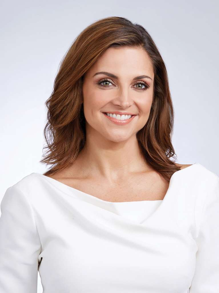 Headshot of Paula Faris