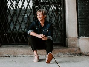 Danielle Strickland sitting on a curb