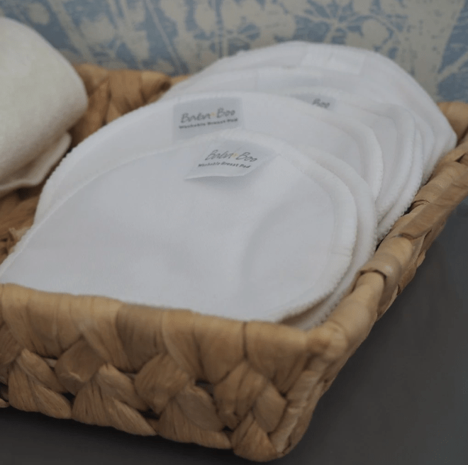 reusable cloth bamboo make up breast pads in a wicker basket