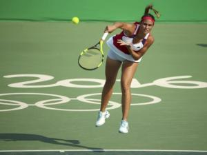 Monica Puig with a strong serve. One of her many skills that helped her to oust number 3 seed Garbine Muguruza just days ago!