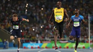 75% Happiness 25% Anguish: Usain Bolt catches a glimpse of his time as he crosses the finishing and is somewhat disappointed. However, there is an immense smile celebrating his back-to-back-to-back Olympic Champion status in the men's 200 meters.