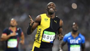 Elation; As Bolt passes the finishing line, his smile says a thousand words. Gold medal Champion at three consecutive Olympics. Living Legend.