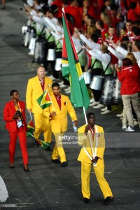 Winston George proudly bearing the Guyanese Flag at the 2012 London Olympics.