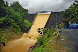 Roseau Dam spilling sediment-laden waters. Photo Credit: Horst Michael Vogel