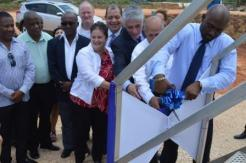 Minister of Energy Science & Technology Andrew Wheatley cutting the ribbon last August. (Photo: Canadian High Commission)