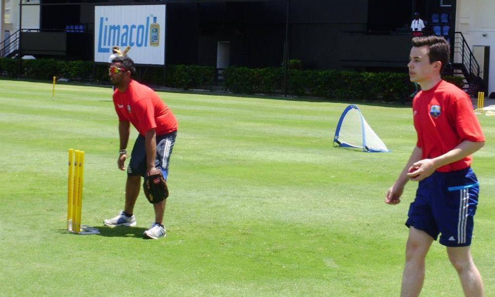 Two cricket coaches volunteering in St Lucia