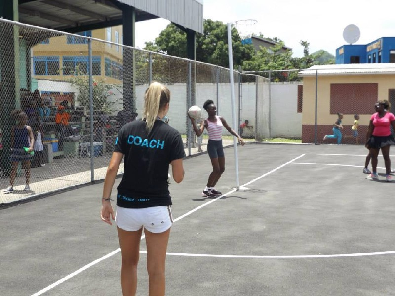 Gap year netball coach assisting a session in St Lucia