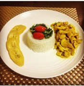 My home-cooked curry chicked with Jasmine rice and sweet steamed plantains.
