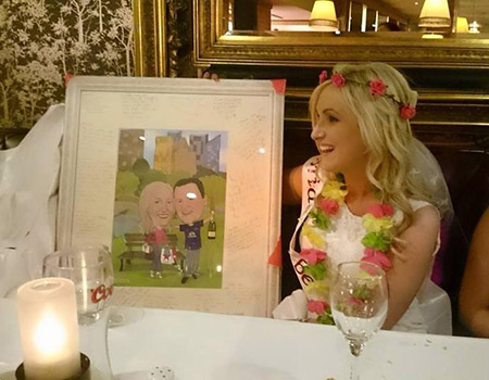 Bride receiving a framed caricature gift on her hen party/bachelorette party