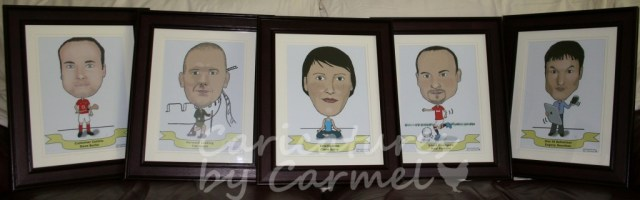 Five framed caricatures for company awards