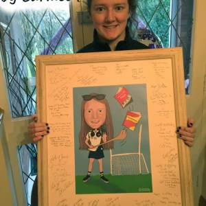 Amy with her framed caricature guest signing board after her 21st birthday party