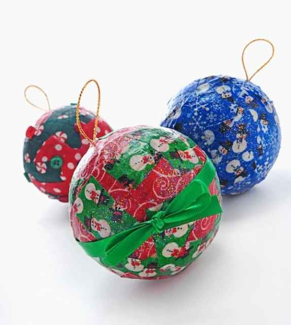 http://modpodgerocksblog.com/2009/11/fabric-ornaments-with-your-little-ones.html