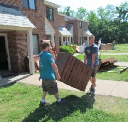 Furniture bank movers moving dresser