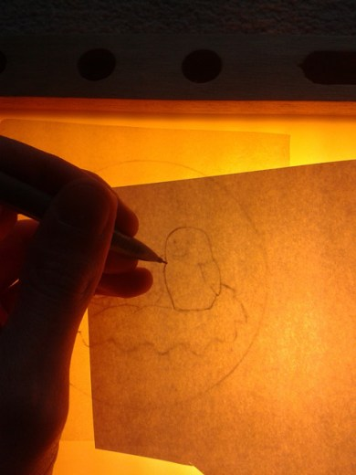 Tracing a part from greaseproof paper onto paper