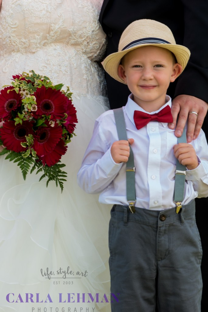 Cute little rustic ring bearer at this Camrose wedding.