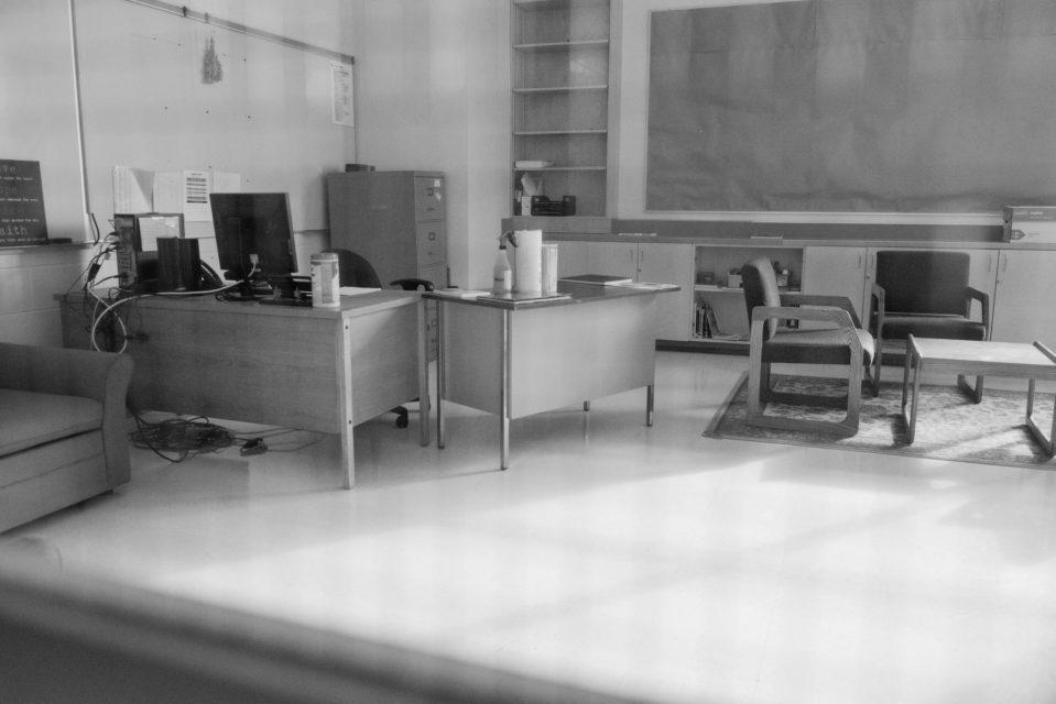 Empty classroom behind locked doors. Documentary Photo Essay