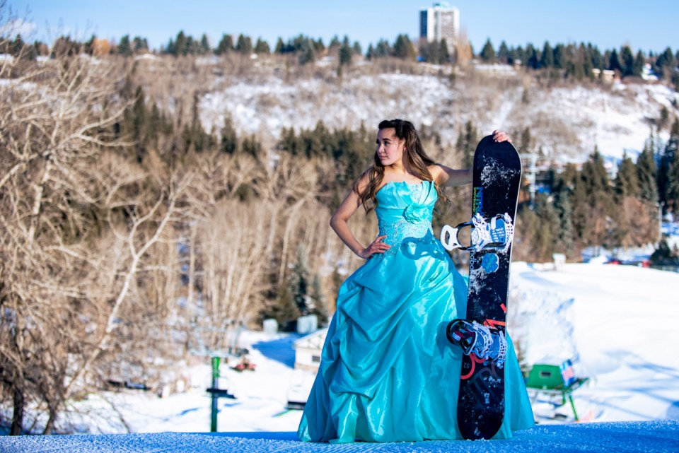 At the top of the world, Zoe Snowboarding in her Grad Gown