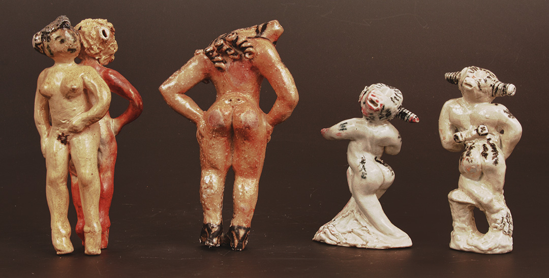 Back view image of Four Cast of Character Whistles