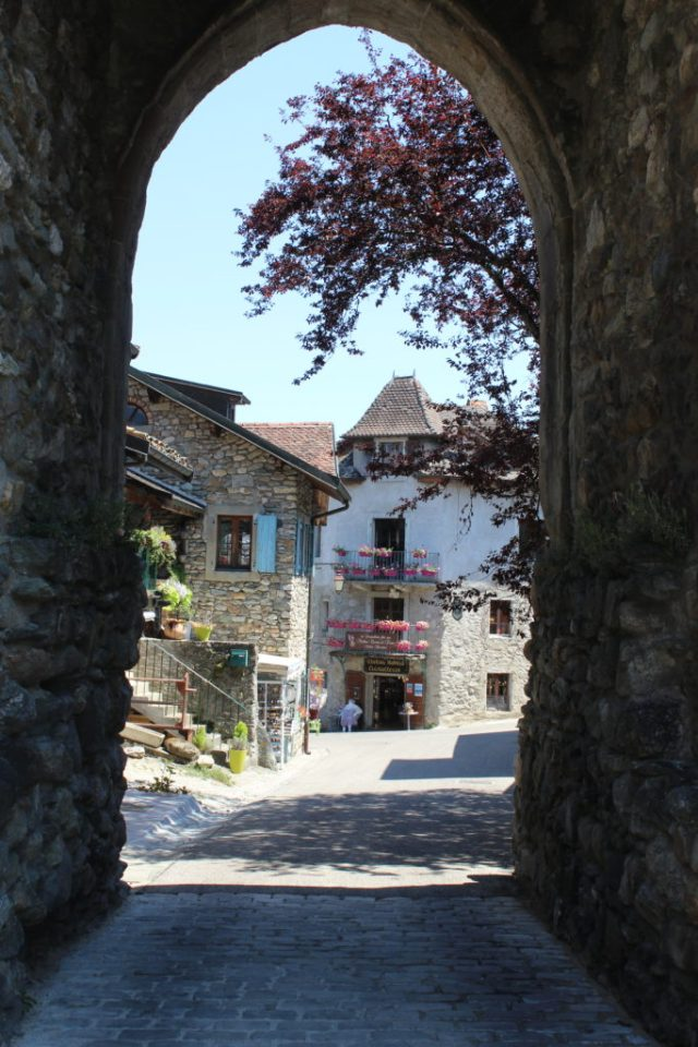 Stone entryway into medieval town of Yvoire France
