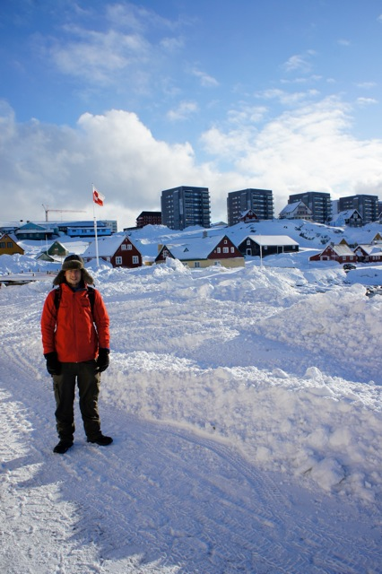 Standing by the harbor in Nuuk's Old Town on a clear day. Note the more traditional Scandinavian-style houses in the mid-ground, with larger modern residential buildings in the background. Photo credit: Jill Rajewicz