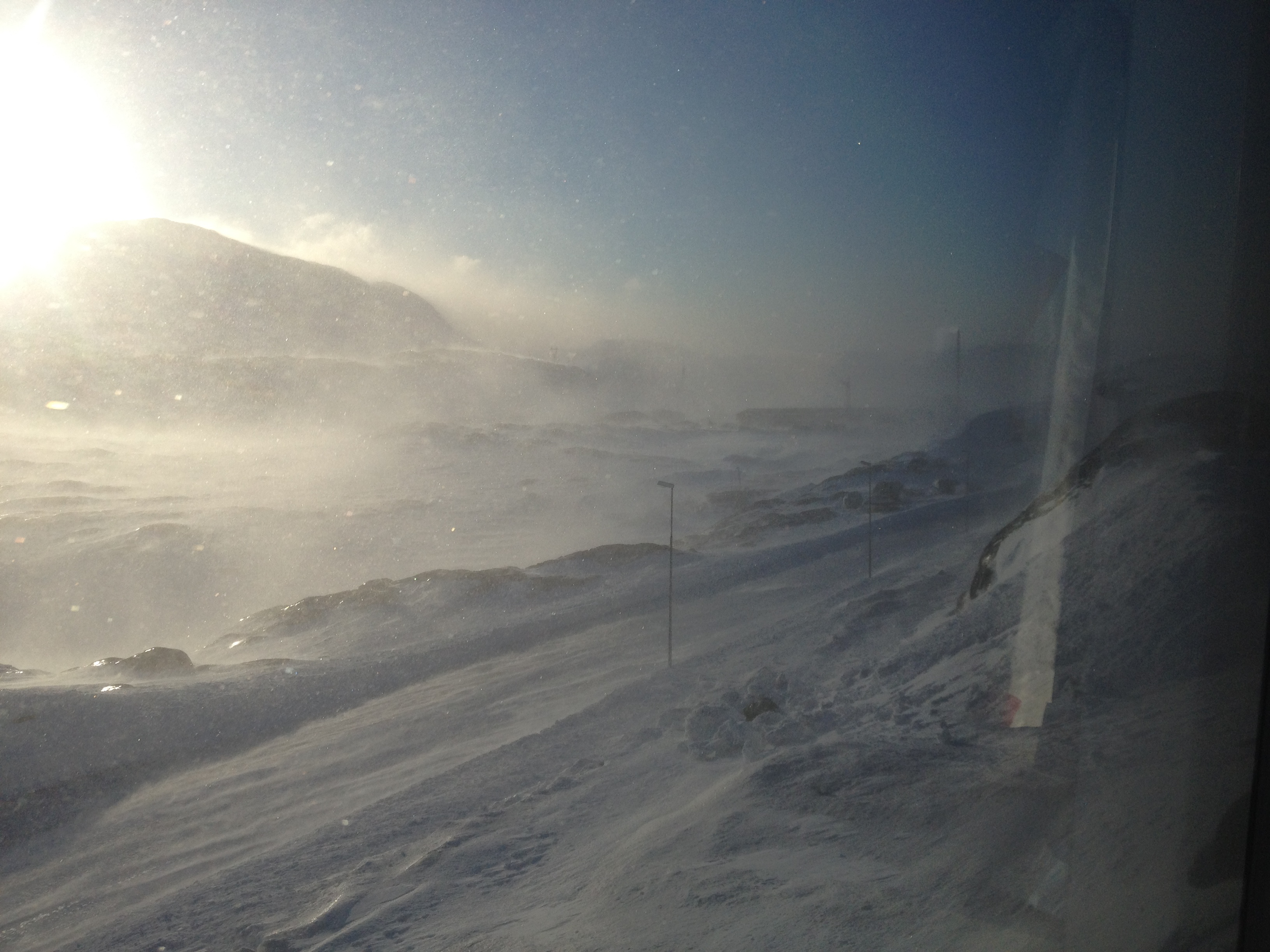 A view of blowing snow out of the window of the Greenland Institute of Natural Resources (GINR) residence building. This is my favourite kind of weather.