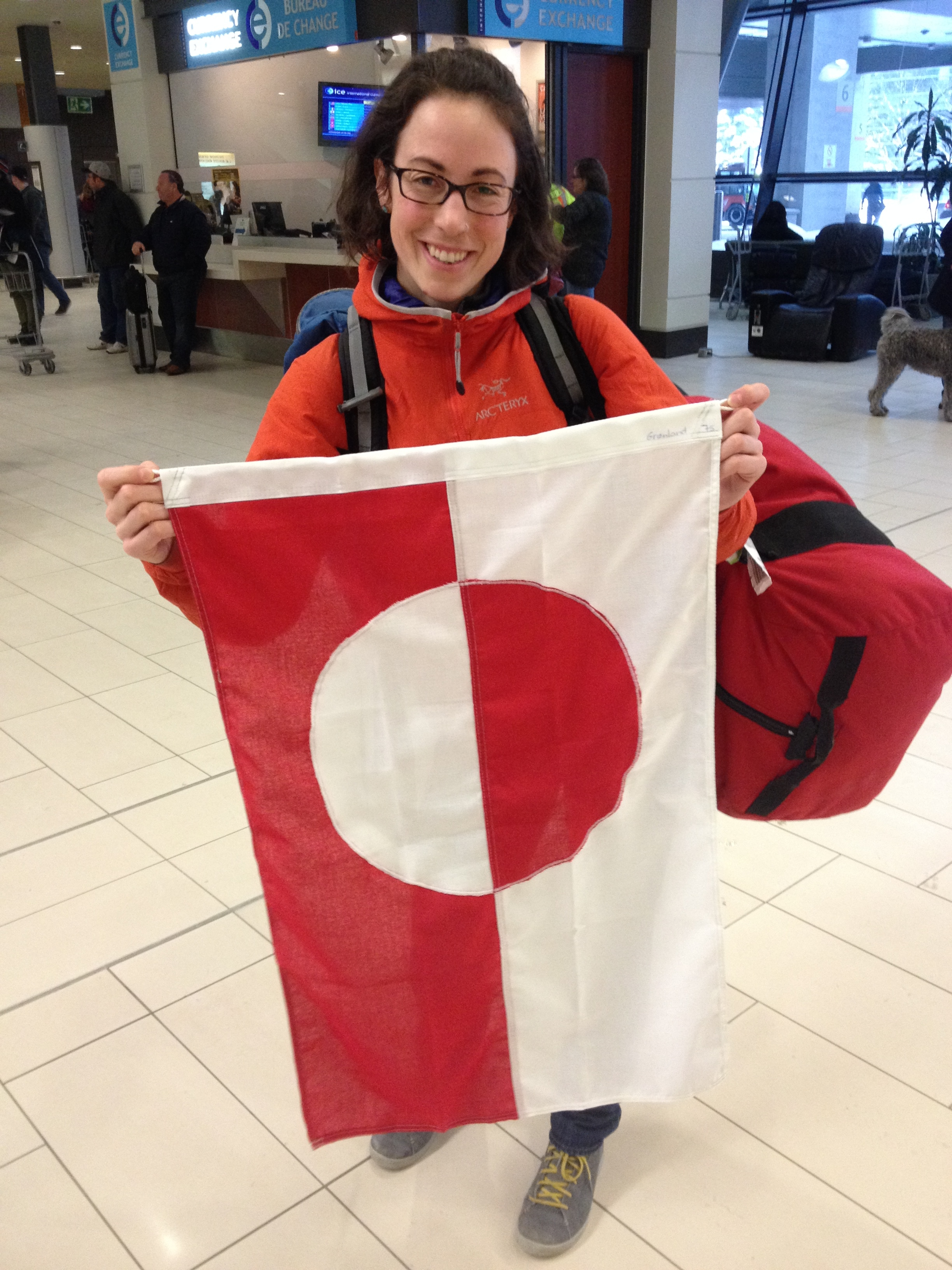 Carleton M.Sc. student Jill Rajewicz holds up the Greenland flag upon our return home to Ottawa.